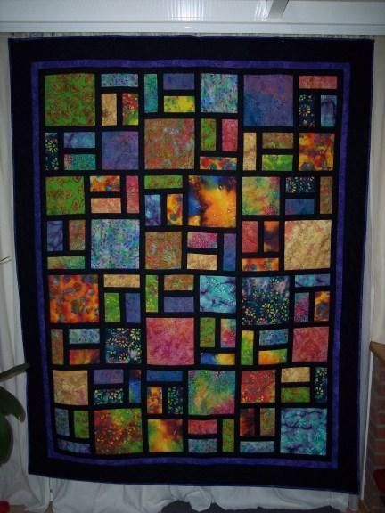 I love how batik fabriks can transform a quilt into a for Window pane quilt design