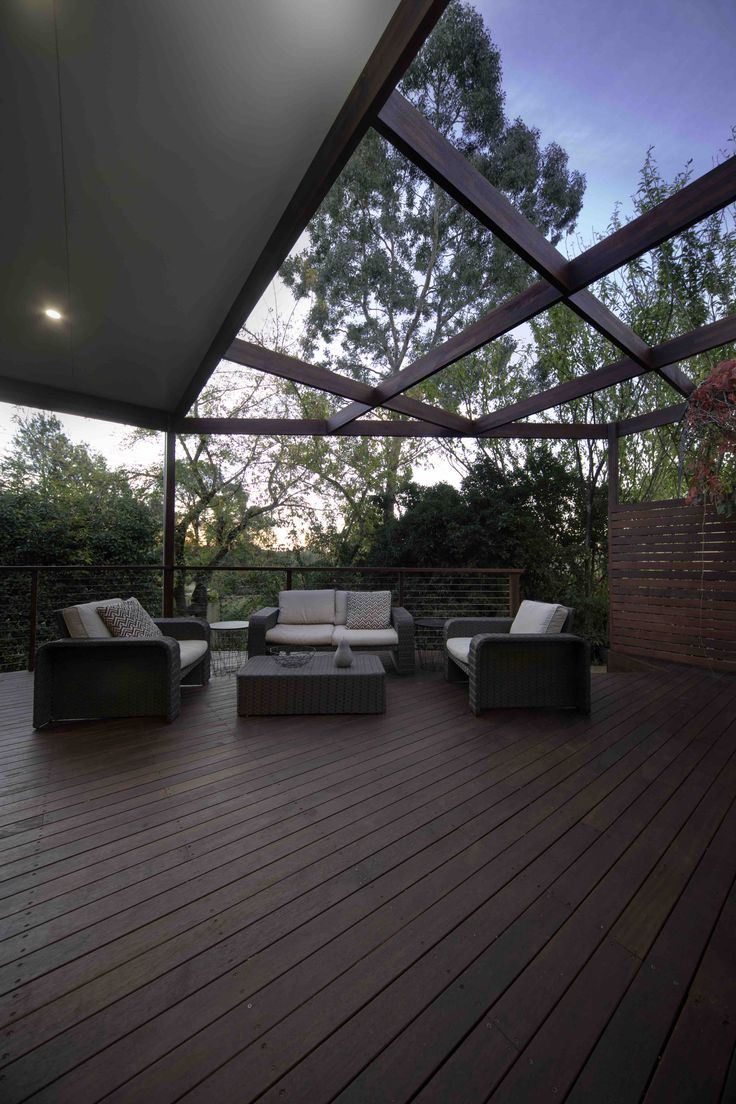 Merbau decking, outdoor settings, decks, pergolas, privacy screens.  Construction by ACT