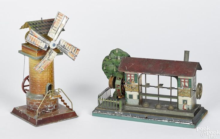 Two tin steam engine accessories, to include a Krauss & Mohr lithograph trip hammer motor house - Price Estimate: $300 - $400