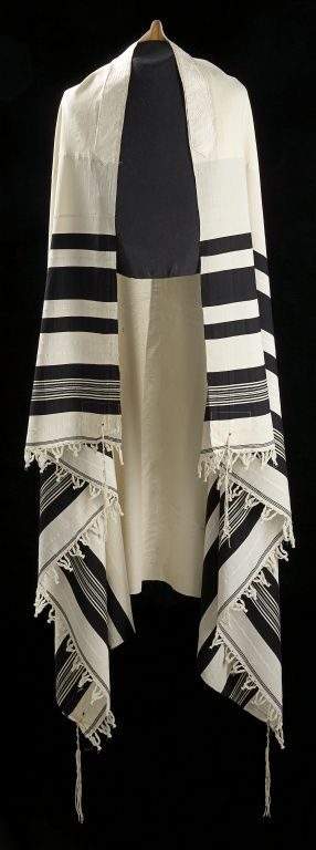 """1883 Russian Jewish Man's Tallith or Tallit at the Glenbow Museum, Calgary - From the curators' comments: """"Israel Ziselman, an Orthodox Jew, received his finely woven wool tallit (prayer shawl) at his bar mitzvah (coming of age celebration) in Russia in 1883. The tallit is fringed at the four corners to serve as a memory guide for observing the commandments. Ziselman left the Byelorussian district of Russia for Canada in 1901, and settled in Calgary in 1908."""""""