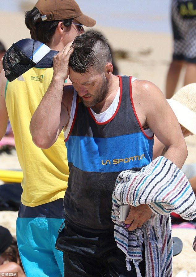 New hair, don't care! Australian actor Joel Edgerton sports new mohawk as he beats the scorching summer heat with a dip at Bondi Beach