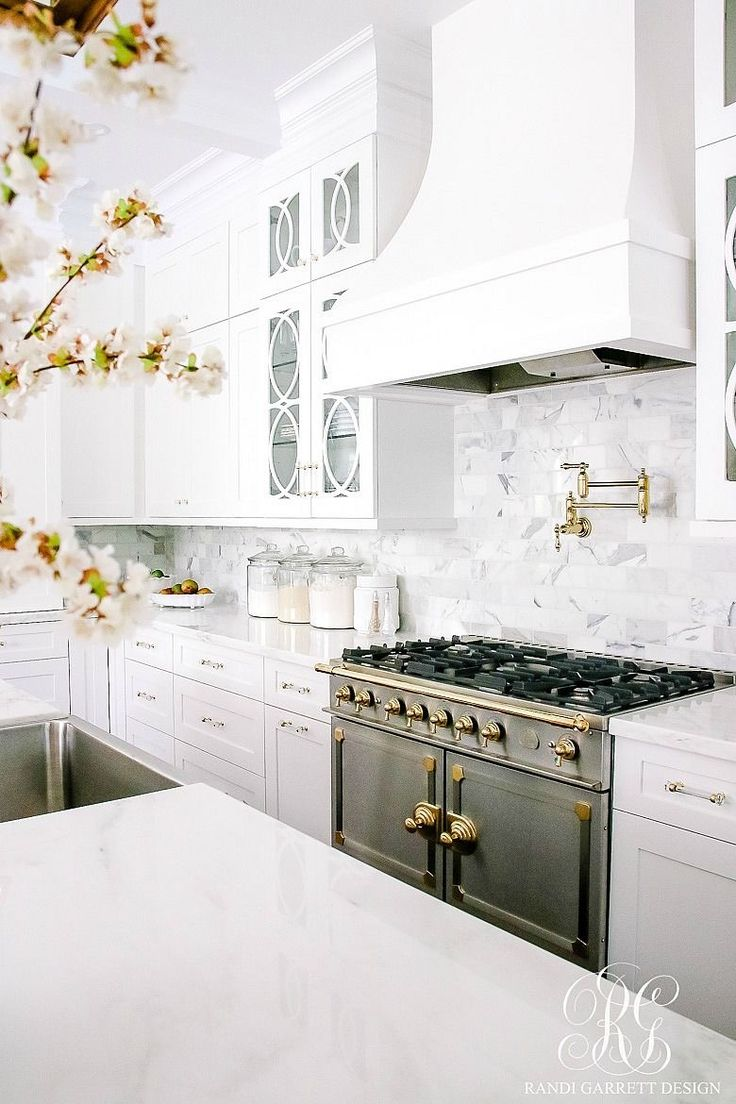 3265 best k i t c h e n s images on pinterest dream kitchens stunning white transitional kitchen with brass chandeliers faucets pot filler and handles two toned la cornue stove the best of interior decor in
