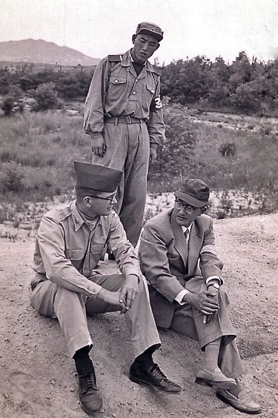 1957: Panmunjom, Korea | North Korean and U.S. soldiers and Voice of the United Nations Command radio announcer.