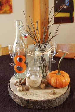 DIY fall themed centerpieces from Allison & Eric's offbeat, rustic DIY wedding in Maryland