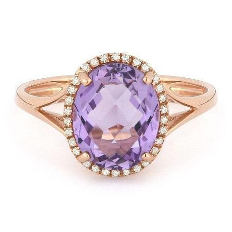 14k rose gold amethyst and diamond oval shaped halo ring. This ring features a 2.65ct oval shaped amethyst accented by an oval shaped halo of .10cttw of round d