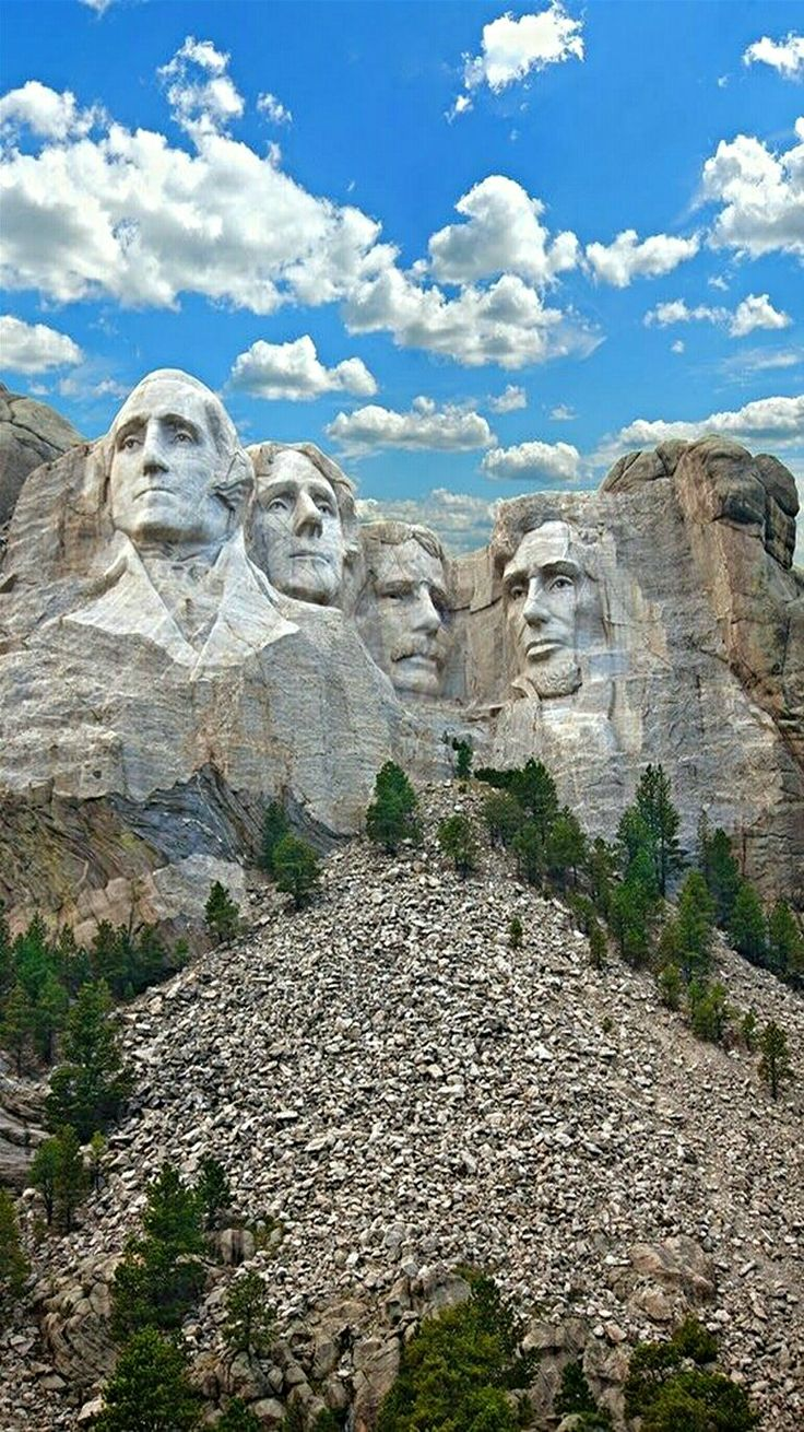 Mount Rushmore National Monument in South Dakota. Nestled in the Black Hills it symbolizes freedom and hope for America. U.S. presidents carved sculptures  of George Washington, Thomas Jefferson, Abraham Lincoln  and Theodore Roosevelt.
