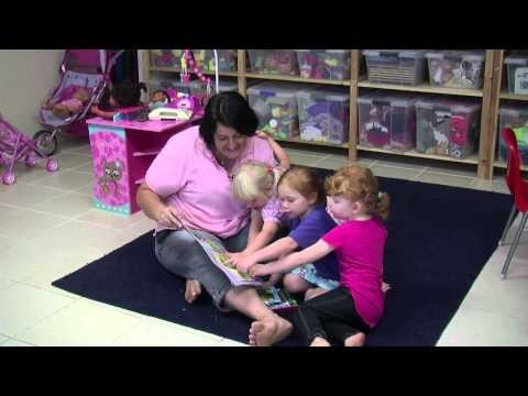 Vignette No. 15: Story reading with three children... This vignette shows an educator reading a book with 3 to 4 year olds. Creating small, open interactions with each child that support the acquisition of early literacy in life and learning.
