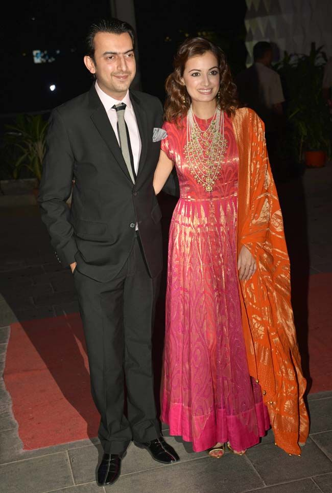 Dia Mirza with husband Sahil Sangha at Tulsi Kumar's wedding reception in Mumbai. #Bollywood #Fashion #Style #Beauty