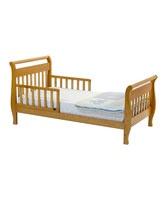 This solid pine sleigh bed is just the transitional piece a toddler needs between outgrowing the crib and moving on to a full-size bed. Fitted with side rails, it offers extra snoozing security and sits low to the ground.29.5'' W x 28.13'' H x 57.88'' LSustainable New Zealand pineNon-toxic finish