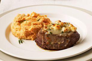 Cheese-crusted Beef Tenderloin Steaks     ■2     beef tenderloin steaks (1/2 lb.)          ■1/8    tsp. kosher salt          ■1/8    tsp. black pepper          ■1/4    cup KRAFT Shredded Italian* Five Cheese with a TOUCH OF PHILADELPHIA          ■2    Tbsp. ATHENOS Crumbled Blue Cheese          ■1/2  tsp. chopped fresh chives