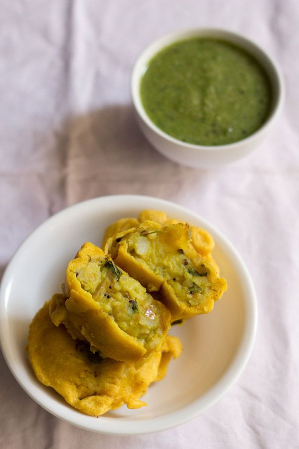 """""""aloo bonda or potato bonda - fried tea time snack from south indian cuisine. made with gram flour & rice flour batter & stuffed with spiced mashed potatoes"""" from VegRecipes of India"""