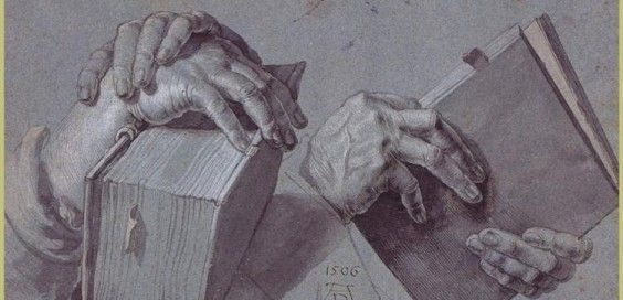 two-hands-holding-a-pair-of-book