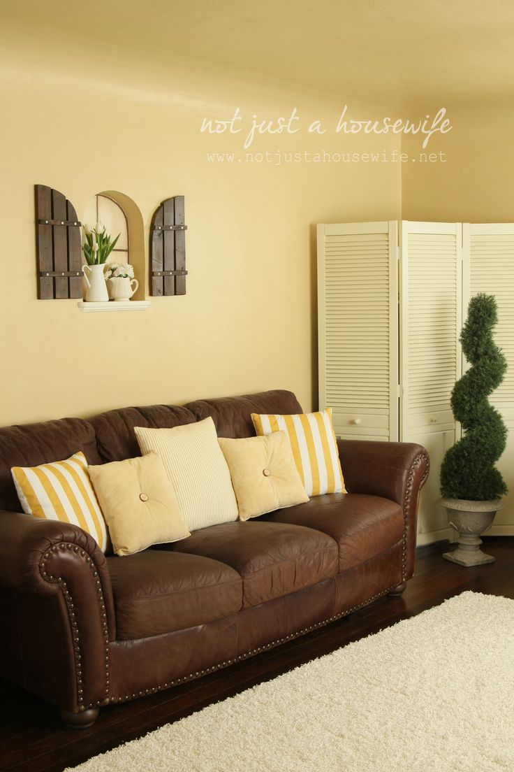 yellow walls brown furniture | My Web Value