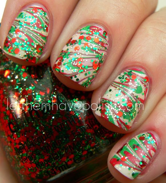 Merry Christmas!!! Holiday Watermarble with Bettina Nail Polish by Let them have Polish! Used: Bettina Marshmallow base, Bettina Mojito, #15 and Marshmallow for water marbling, China Glaze's Party Hearty (the ultimate Holiday glitter) on top, then two coats of Hard Candy Mattely in Love as top coat.