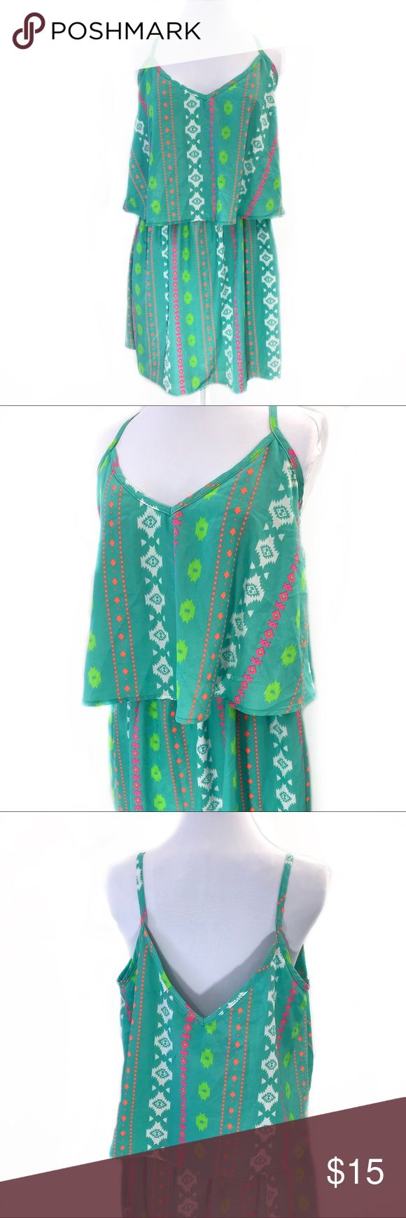 Bright Colored Aztec Southwest Flutter Neckline Bright Colored Aztec Southwest Flutter Neckline  Summer dress ready for an evening out after hitting the beach. Bright aqua, pink, orange, green, and white print. Drape flutter neckline, elastic waist. Low, v-back. Light chiffon fabric, opaque. BeBop Dresses