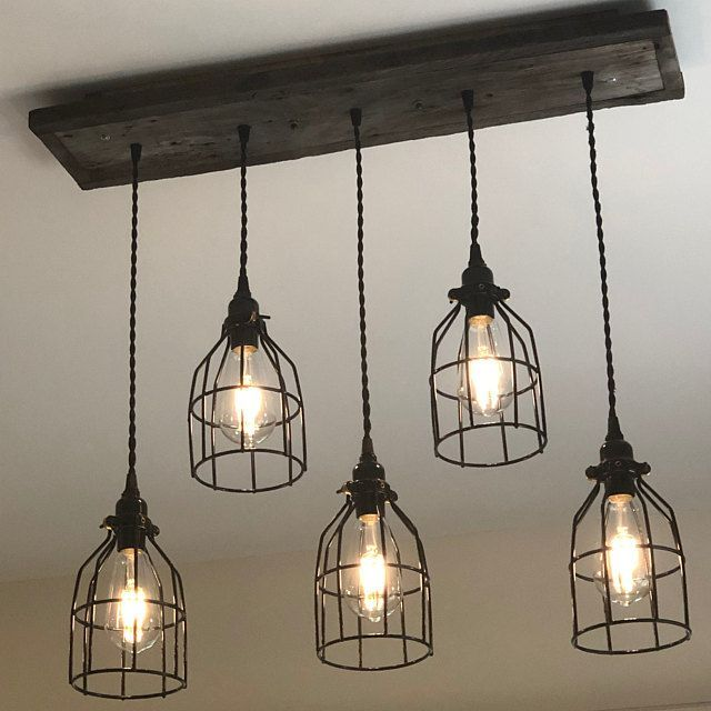 The Eagles Nest Rustic Barn Wood Chandelier Etsy What Is The
