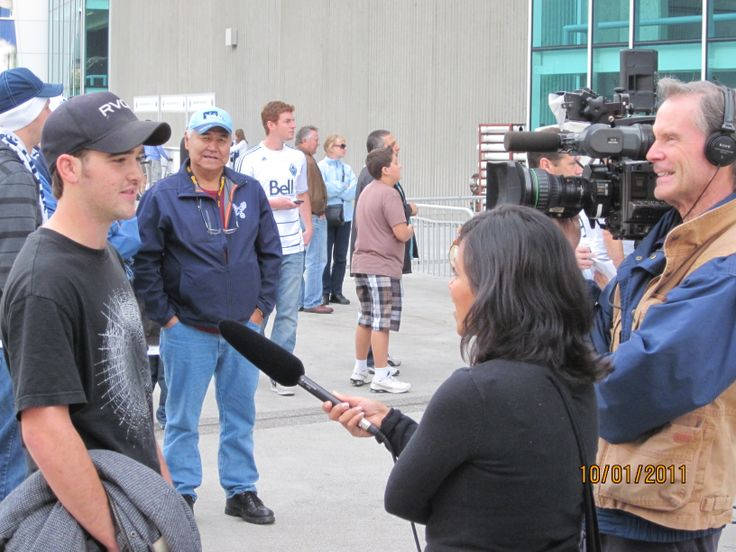 TJ being interviewed by the news @ the first Whitecaps game at the newly renovated BC Place
