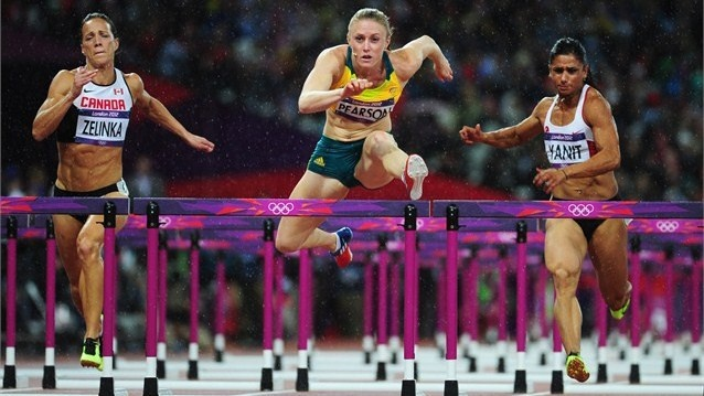 Sally Pearson of Australia wins gold  Sally Pearson of Australia leads Jessica Zelinka of Canada and Nevin Yanit of Turkey during the Women's 100m Hurdles Final on Day 11 of the London 2012 Olympic Games at Olympic Stadium