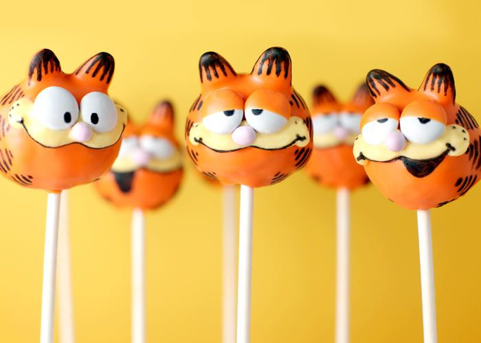 Garfield cakepops. Bakerella is a genius. His ears are candy corn and his eyes are M & Ms half-way dipped in candy coating...genius!