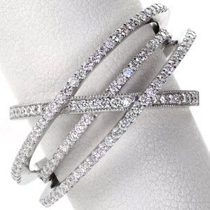 Fireworks Band - The Fireworks Band is a glamorous, heirloom quality right hand ring. This mesmerizing design uses four split-shank bands to create layers and add dimension to the entire piece. Each band is set with micro pavé to dazzle the eye with bursts of white and rainbow light.