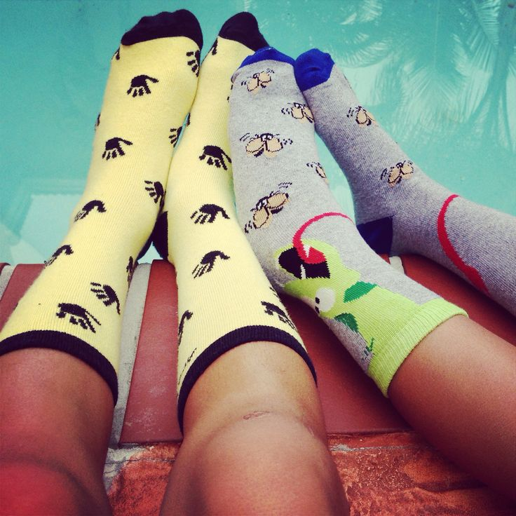 Brotherly love hanging out by the pool with their cool Are You Kidding socks!