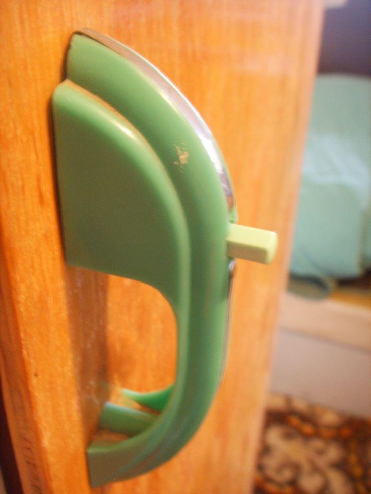 Pre-reno. Green bakelite cupboard handle.