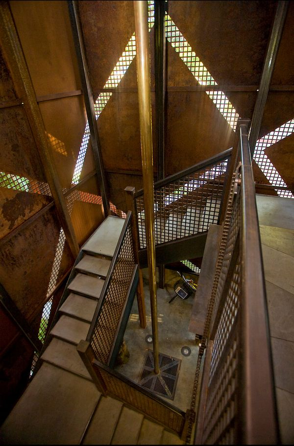 #Industrial style #staircase with mesh detailing and #brass fire pole