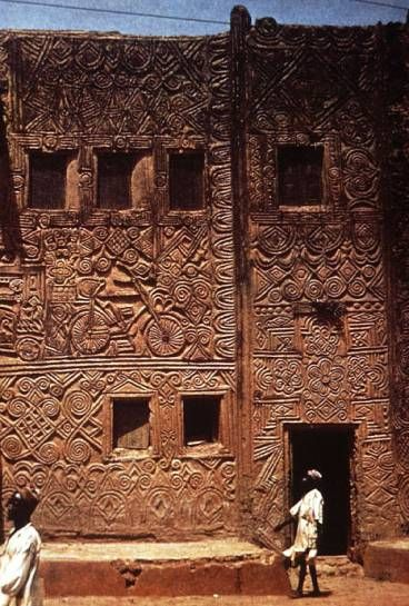 "From a lecture on #African #Architecture... ""One is impressed above all by the symbolic imagery of traditional African building. Using mud may have certain technical disadvantages, but it is probably the most expressive of all materials. It not only lends itself brilliantly to surface decoration, but the very shapes of the buildings express their functions and their ideology."" Shown here is a beautifully decorated house facade in Zaria, Nigeria."