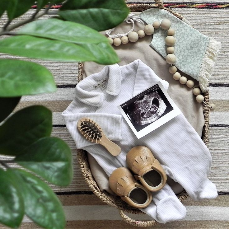 Flatlay nursery baby basket with our coffee moccs