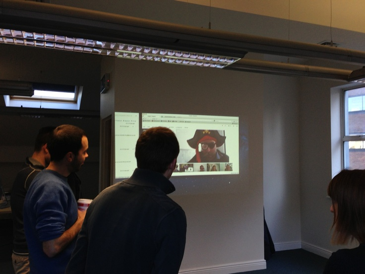 Captain Gus gives his update from Berlin while Dublin looks on. Google Hangout is proving fun for cross-continent morning stand-ups!