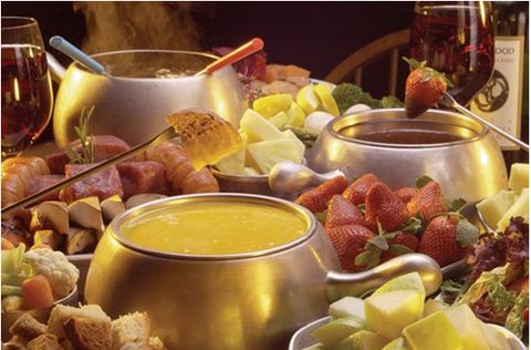 Fondue at the reception is a MUST! It may be a bit messy, but we'll figure that out so that it's not (mini bowls to keep individual fondue?). Either way- it's a must! | Unique Wedding Food Ideas That Will Leave Your Guests Satisfied — Bride Couture