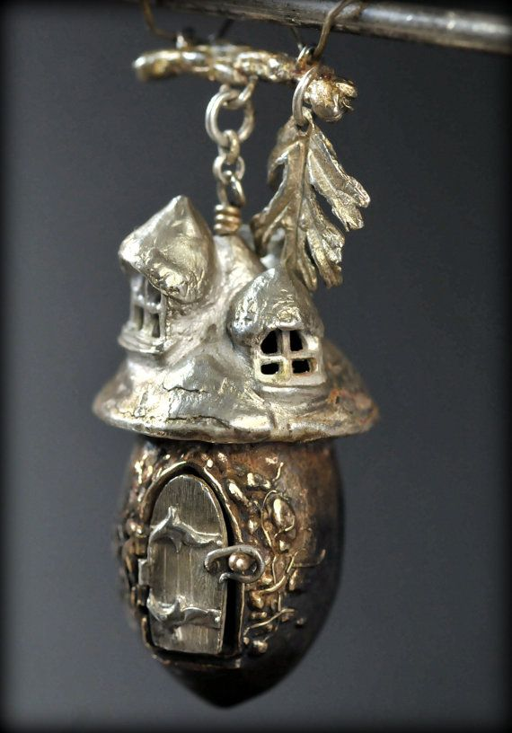 New!! Fairy house pendants in solid sterling silver and bronze. This is the bronze acorn with the sterling silver roof cap. It comes hung on a branch