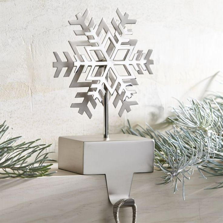 Here's one snowflake that won't melt.  Hefty enough to anchor a stocking to the mantle, this mixed-metal hook features a snowflake icon in a dual matte and shiny finish on a matte-finish base.  Row them up or mixed with other stocking hooks for an eclectic effect. Aluminum, steel and ironClean with a dry clothMade in India.