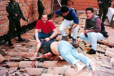 africansouljah:  DEA agent Steve Murphy grasping Pablo Escobar's body.