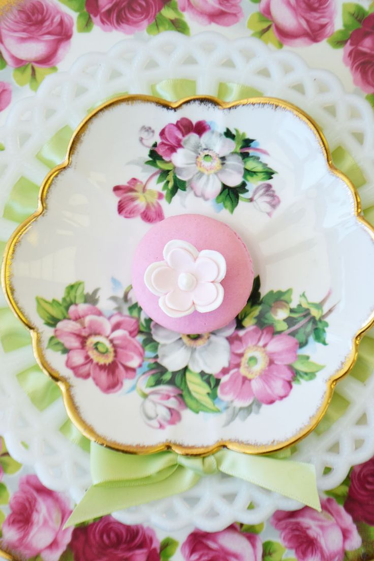 Floral macaron on vintage china saucer. Macaron from Bake Sale Toronto. China from Vintage Dish Rental