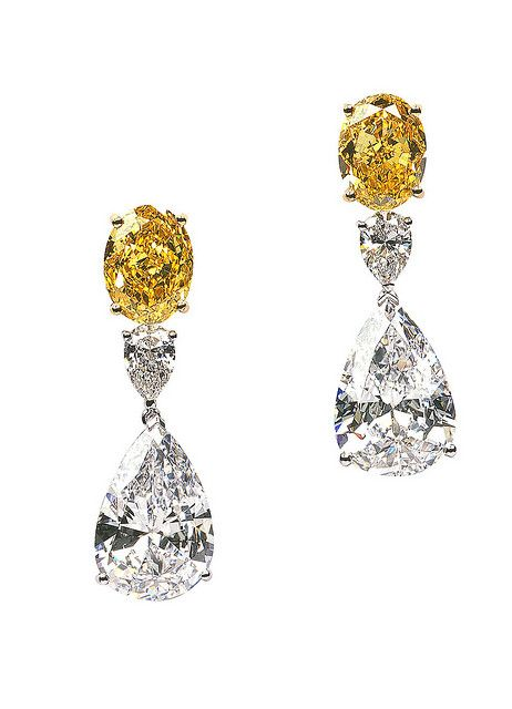 Six Diamonds - Two Intense Yellow Ovals and Four Colorless Pears, all set in Platinum, Create this Pair of Earclips. Van Cleef & Arpels.