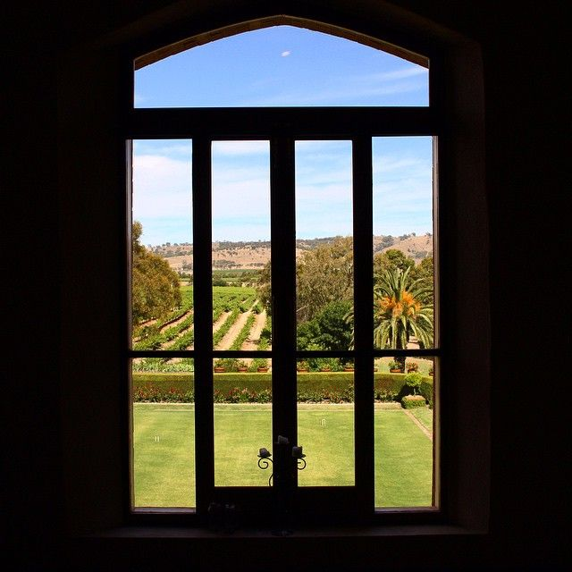 Through the looking glass at Chateau Tanunda... View East over the croquet lawn and vineyards from the Long Room.  Image by BarossaDirt on Instagram.  #barossadirt #barossa #barossavalley #chateautanunda #winery