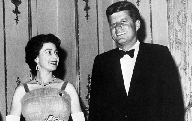 Queen Elizabeth II and United States President John F Kennedy meet at dinner in 1961.