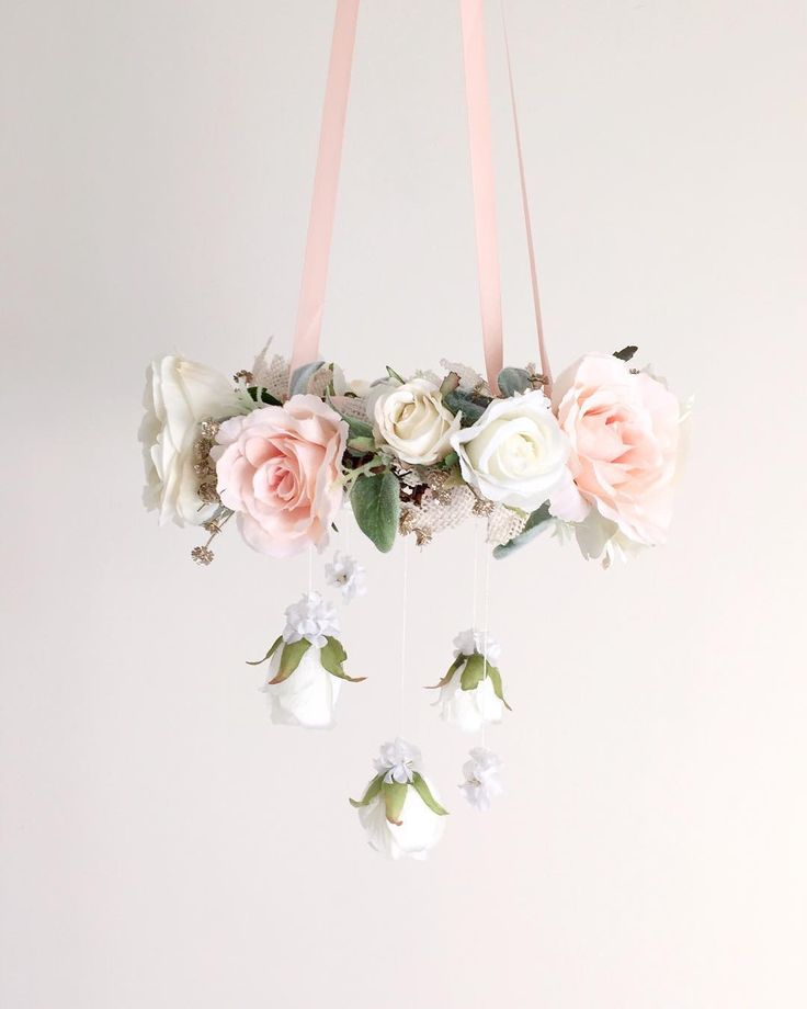 I received an inquiry from a customer to create a smaller version chandelier to hang above a special little baby girl's bassinet so I went ahead and tried my hand at making one. Ironically, I think it took me the same amount of time to create as a larger chandelier! All of those teeny tiny flowers and details are worth it in the end though ---------------------------------------------------#handmade #itsagirl #nurserydecor #nurserydesign #interiordesign #20weeks #babygirl #babymob...