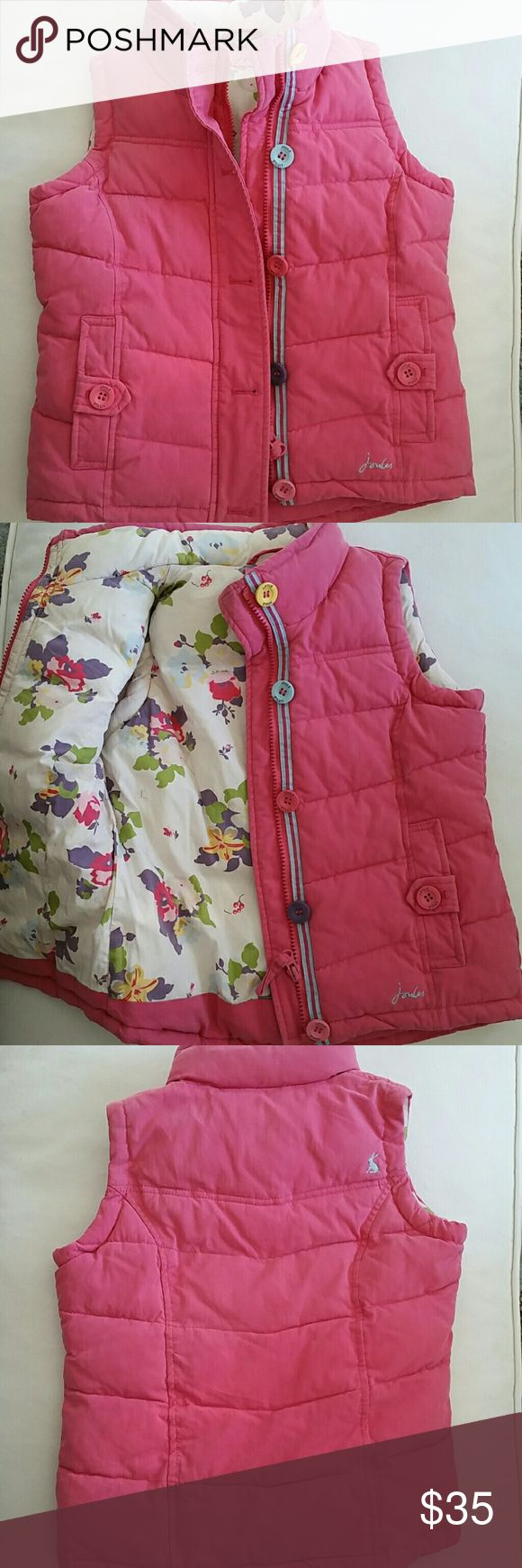 Joules Gilet Vest padded pink w/ floral lining Joules Gilet Vest padded pink w/ floral lining and cute button detail.  This vest is very warm,  super adorable, love the floral lining! In good condition, has been worn, but no stains, still quite lovely! Joules Jackets & Coats Vests
