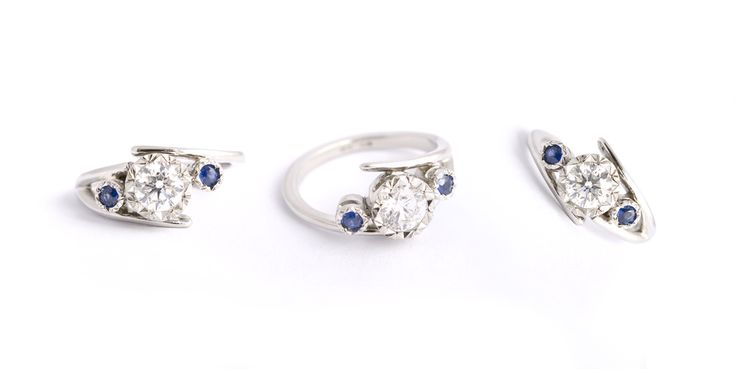 Platnium engagement ring with diamond and blue sapphires
