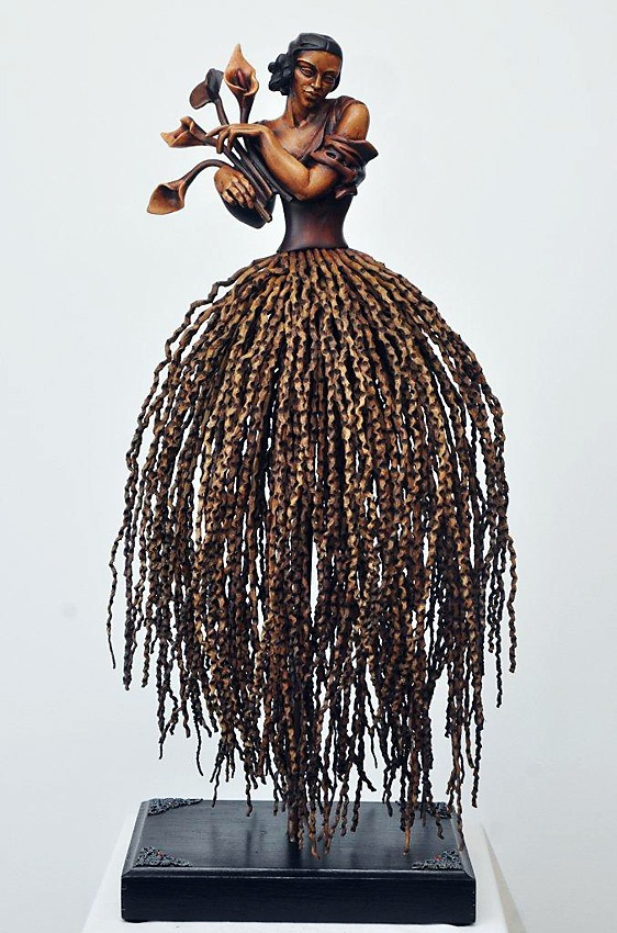 "The unique wood-sculptures are created by a talented artist, using resin/clay and the indigenous Coco Pamosa's palm fronds sculptured wood figure - TAMARA- FINISH IN NATURAL WOOD approx 30"" tall (750mm) available at http://phasesafrica.com"