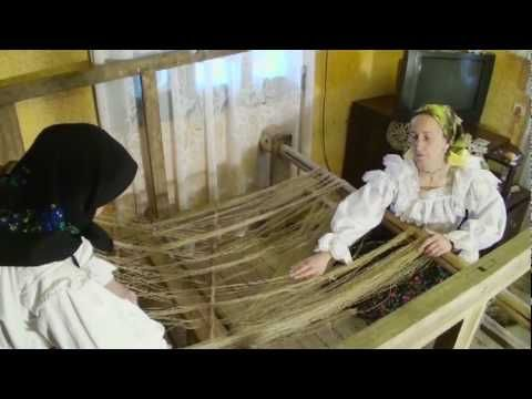"Warping an old 2-shaft loom. In Romanian, but they show the whole process, and it is interesting to see. Part 1 of 2.  Cum se pune ""Tiară"" (război de țesut) - part 1 - YouTube"
