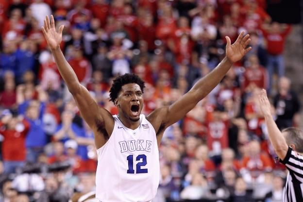 Justise Winslow raises his arms in victory! :)