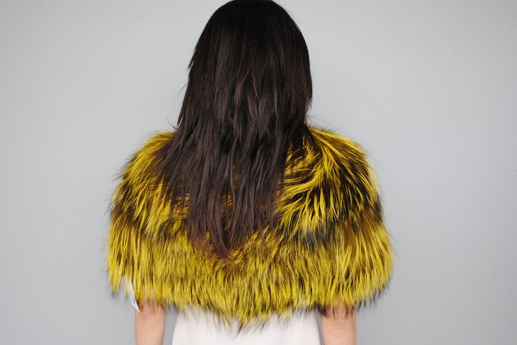 Get yourself immersed in the colour culture of fur with this edgy yellow coloured small fox vest.