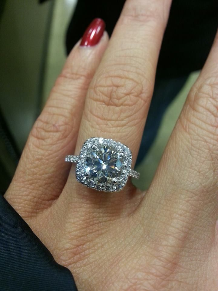 Cindy's fiancé proposed with a Ritani cushion halo engagement ring. Its center stone is 2.1-carats. Such incredible sparkle! Congratulations.