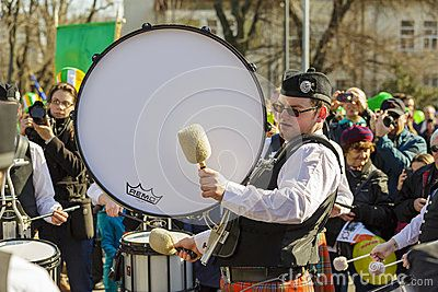 St. Patrick's Day Parade. Unidentified kilted Irish drum band plays the drums during the 2nd St. Patrick's Day Parade on March 16, 2014 in Bucharest, Romania. Download this Editorial Photography of Irish Drum Band During St. Patrick's Day Parade for as low as 0.68 lei. New users enjoy 60% OFF. 22,147,250 high-resolution stock photos and vector illustrations. Image: 38907237