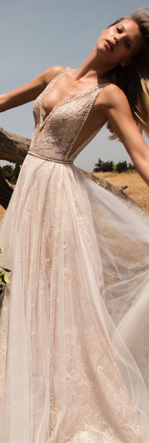 GALA-711 Big pleated ball gown made of french-lace in an exquisite shades of cappuccino and sparkly accents. The dress has hidden pockets, big pleated skirt, deep plunging v-neck with illusion of sheerness throughout.