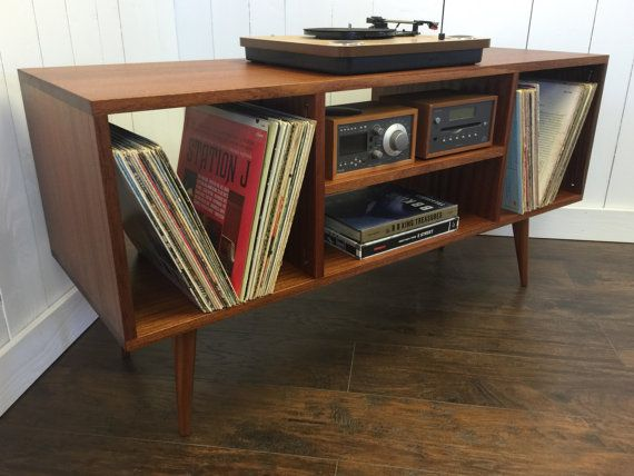 Mid century modern stereo/turntable console or TV/media cabinet featuring sapele mahogany with tapered wood legs.