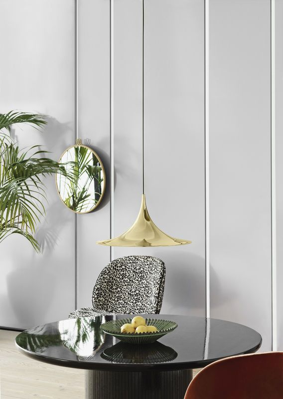 GUBI // Beetle lounge chair with Pierre Frey Jungle upholstery, Semi pendant in brass - size Ø47, Randaccio mirror size Ø60 and a Moon table - Ø120 - midnight moon glossy